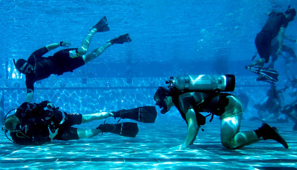 November 5, 2019 - Mass Communication Specialist 3rd Class Alex Perlman (left), assigned to Commander, Naval Special Warfare Command (NSWC) photographs U.S. Navy SEAL candidates participating in Basic Underwater Demolition/SEAL (BUD/S) training. NSWC is the maritime component of U.S. Special Operations Command, and its mission is to provide maritime special operations forces to conduct full-spectrum operations, unilaterally or with partners, to support national objectives. (U.S. Navy photo by Mass Communication Specialist 1st Class Sean Furey)