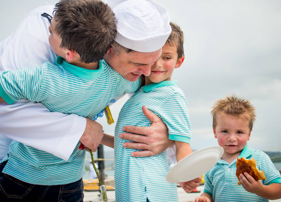 August 18, 2019 - Machinist Mate (Nuclear) 1st Class Nicholas Miller, assigned to the Los Angeles-class fast attack submarine USS Oklahoma City (SSN 723) ... greets his happy sons during a homecoming celebration following a four month deployment. (U.S. Navy photo by Mass Communication Specialist 2nd Class Kelsey J. Hockenberger)