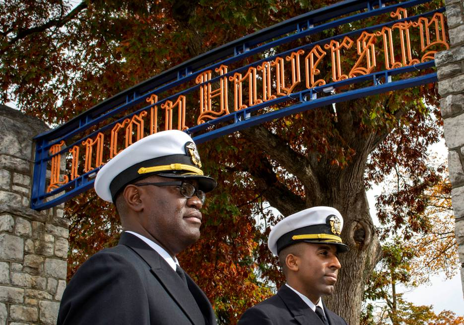 October 30, 2019 - Lt. Cmdr. Lennox Smith, left, from Upper Darby, Pa., and Lt. Charles Banks, from Rochester, N.Y., both assigned to Navy Recruiting District Philadelphia, tour Lincoln University grounds during Navy Visibility Day. Navy Visibility Day is a Navy Recruiting Command proprietary recruitment program designed specifically for the purpose of building long-lasting relationships with universities and colleges, attracting the brightest, diverse college prospects, and showcasing opportunities for both military and civilian careers. Placing emphasis on STEM, this event teaches leadership, features guest speakers and provides networking opportunities with local Navy recruiters. (U.S. Navy photo by Petty Officer 1st Class Diana Quinlan)