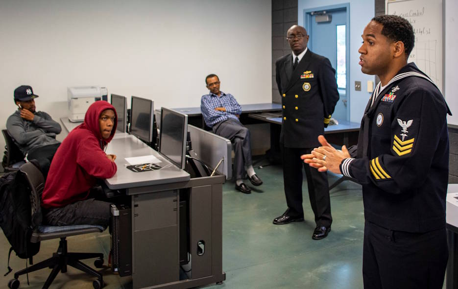 October 29, 2019 - Hospital Corpsman 1st Class David Cooley, from New York, assigned to Navy Recruiting District Philadelphia, speaks to students at Lincoln University, as Lt. Cmdr. Lennox Smith observes during Navy Visibility Day. (U.S. Navy photo by Petty Officer 1st Class Diana Quinlan)