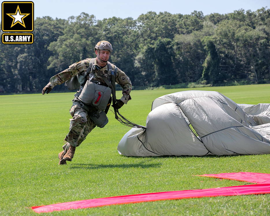 August 4, 2019 - A U.S. Army Paratrooper runs towards the target, marked with an X on Castle Drop Zone during Leapfest 2019 at West Kingston, RI., . Leapfest is the largest, longest standing, international static line parachute training event and competition hosted by the 56th Troop Command, Rhode Island Army National Guard to promote high level technical training and esprit de corps within the International Airborne community. (Image created by USA Patriotism! from U.S. Army photo by Spc. Rafael DiCristina)