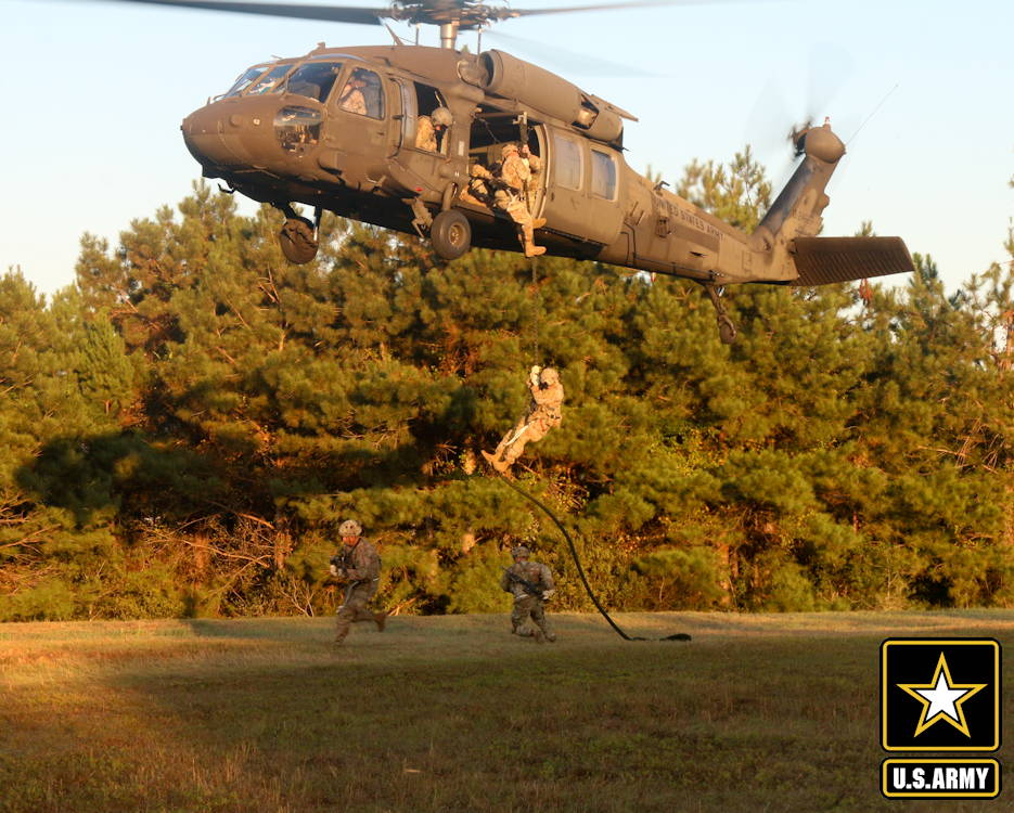 September 29, 2019 - Paratroopers with 4th Infantry Brigade Combat Team (A), 25th Infantry Division, U.S. Army Alaska, fast-rope from a UH-60 Blackhawk during training at Camp Shelby, Mississippi. The paratroopers conducted an Emergency Deployment Readiness Exercise, taking them from their home at Joint Base Elmendorf-Richardson, Alaska, and will continue training at Camp Shelby for more than 20 days. (Image created by USA Patriotism! from U.S. Army photo by Cpt. Ashley Bainsangster)