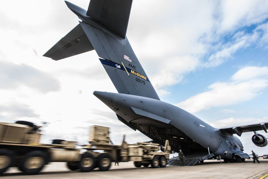 An M902 Patriot missile launcher, pulled by a truck, is unloaded from a 17 Globemaster III. at Fort Sill, Oklahoma, November 5, 2019. (U.S. Air Force photo by Airman 1st Class Ariel Owings)