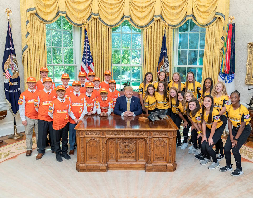 October 11, 2019 - President Donald J. Trump poses for a photo with Little League World Series baseball and softball champs, Louisiana's Eastbank All-Stars team and North Carolina's Rowan Little League team in the Oval Office of the White House. The Eastbank All-Stars team also received a free flight back to Louisiana with President Trump on Air Force One. (Image created by USA Patriotism! from Official White House photo by Shealah Craighead)