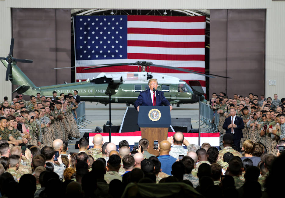 June 30, 2019 - President Donald J. Trump speaks to Soldiers, Sailors, Airmen and Marines during a visit to Osan Air Base, Republic of Korea (ROK) after meeting with the leaders of North Korea and ROK. U.S. Forces across the peninsula are charged with the mission of deterring aggression, defending the ROK and maintaining stability in the region. (U.S. Army photo by Staff Sgt. Cody Harding, 2ID/RUCD Public Affairs)