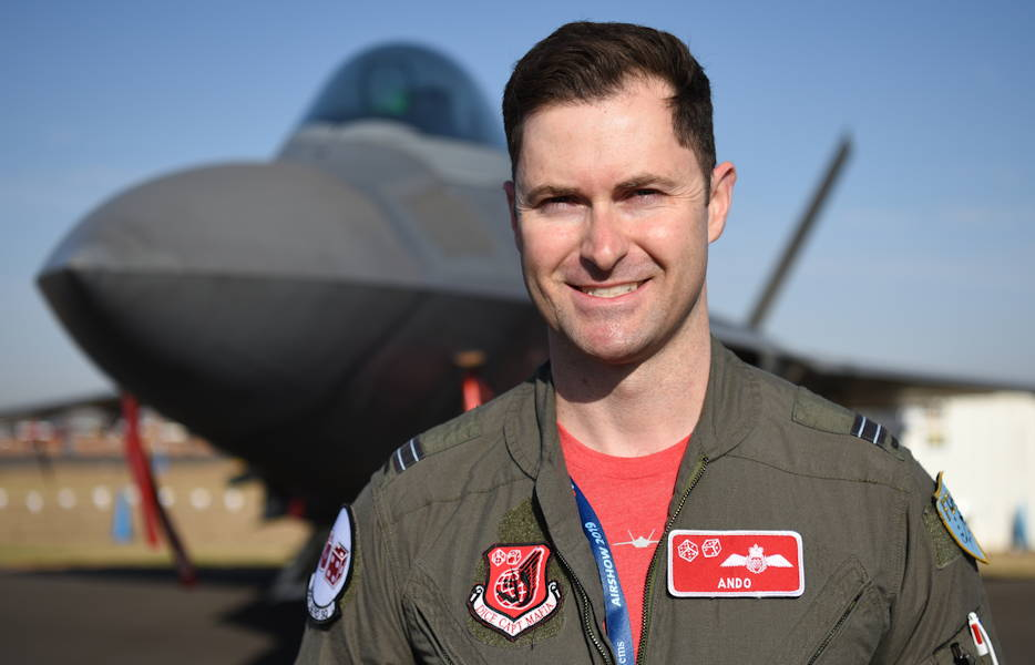 February 28, 2019 - Royal Australian Air Force Flight Lt. Paul Anderton, an F-22 Raptor pilot with the 90th Fighter Squadron, Joint Base Elmendorf-Richardson, Alaska, stands in front of a Raptor at Geelong, Victoria, Australia. Anderton is at the 90th FS as part of the military personnel exchange program where U.S. and foreign military pilots are embedded with counterpart units to share best practices and work closely with one another. (U.S. Air Force photo by Staff Sgt. Sergio A. Gamboa)