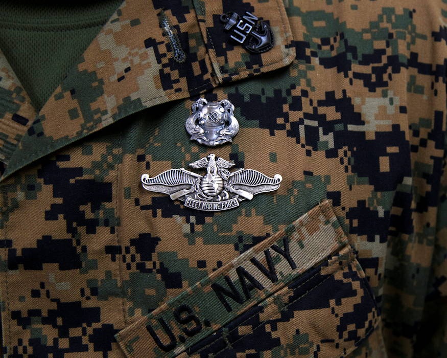 January 9, 2019 - A U.S. Navy diver with 3rd Reconnaissance Battalion, III Marine Expeditionary Force, proudly wears the Fleet Marine Force warfare insignia on his uniform along with his Navy insignia. He had just finished a training exercise involving a Standard Navy Double Lock Hyperbaric Recompression Chamber (SNDLRCS) at Camp Schwab, Okinawa, Japan. (U.S. Marine Corps photo by Lance Cpl. Hannah Hall)