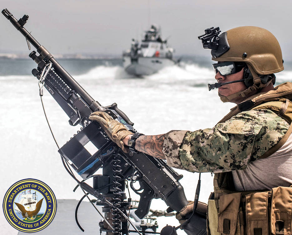 June 13, 2019 - Navy Chief Petty Officer Jaime Villalobos mans a M240B machine gun on a patrol boat during training in San Diego Bay,  California. (Image created by USA Patriotism! from U.S. Navy photo by Chief Petty Officer Nelson Doromal Jr.)
