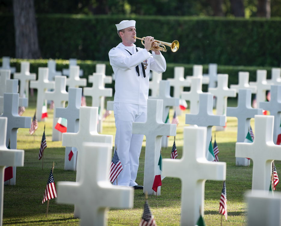 May 24, 2019 - Navy Petty Officer 3rd Class Erik Horne plays taps among the graves of fallen U.S. service members during a Memorial Day ceremony at the Sicily-Rome American Cemetery and Memorial in Nettuno, Italy. (U.S. Navy photo by Navy Petty Officer 1st Class Gregory N. Juday)