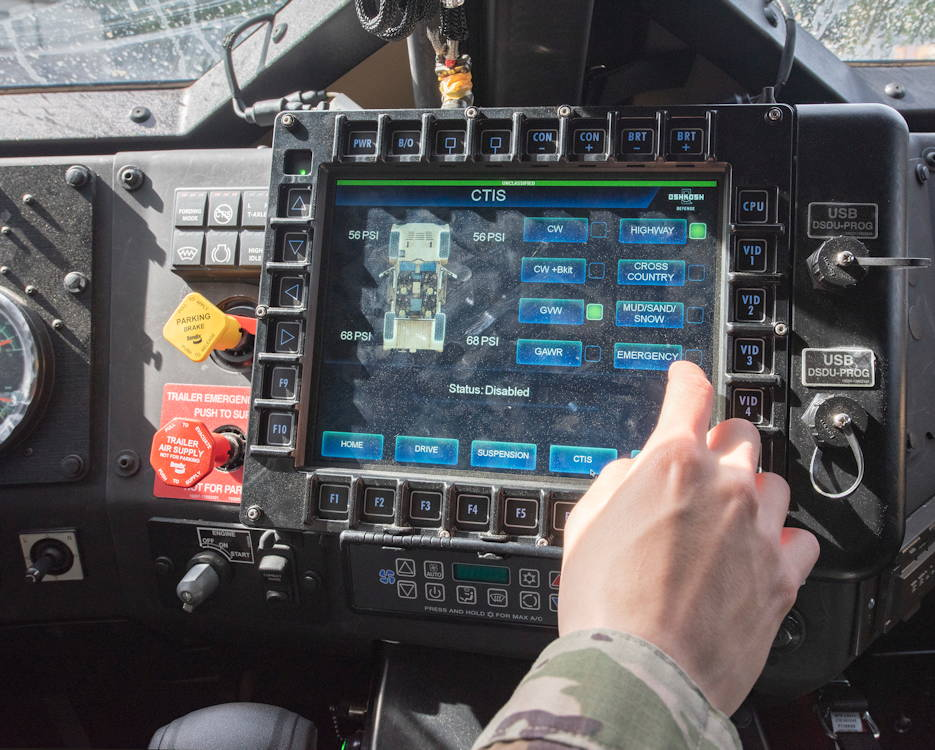 A soldier uses a touchscreen computer inside a joint light tactical vehicle on February 12, 2019. (U.S. Department of Defense photo by Sean Kimmons)