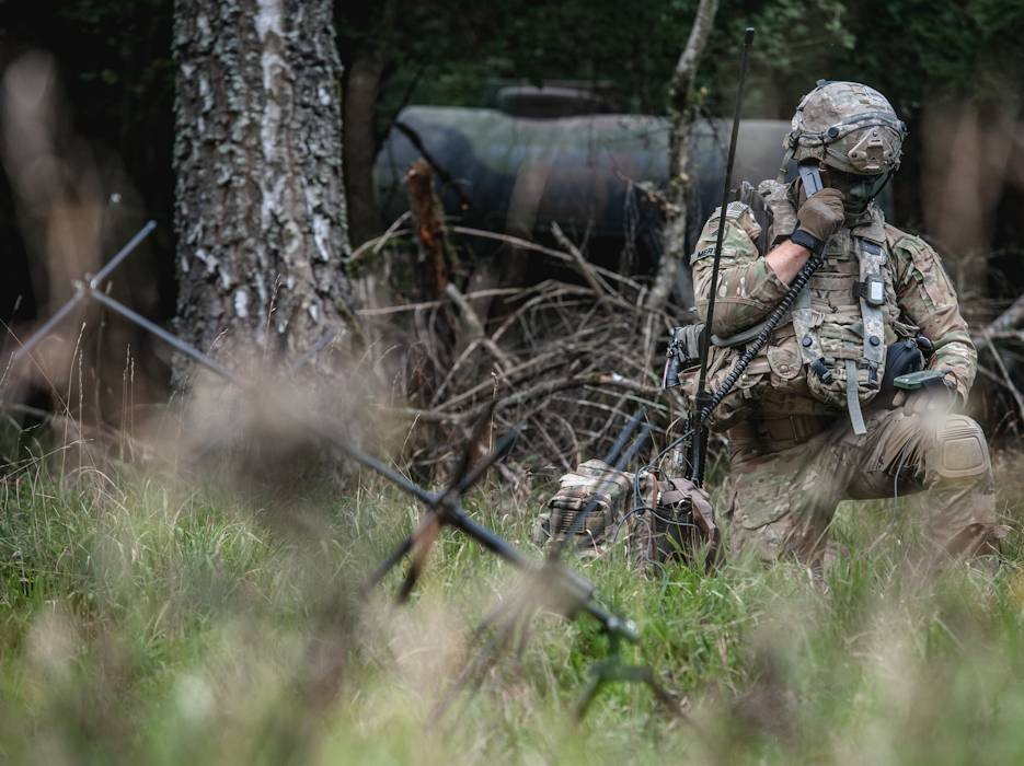 A soldier conducts a radio check with the tactical operations center during Exercise Saber Junction 2019 in Hohenfels Training Area, Germany, September 22, 2019. (U.S. Army photo by Sgt. Henry Villarama)
