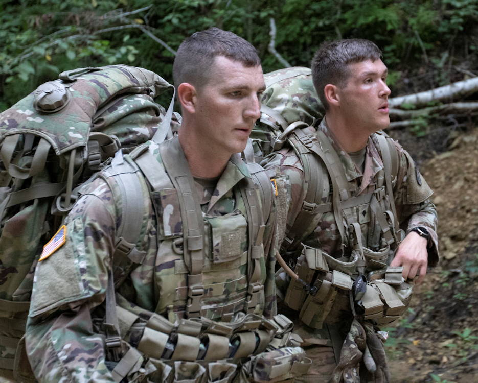 U.S. Army Reserve Sgt. Joshua Smith and Spc. Collin George continue their ruck with each carrying 70 pounds worth of gear through the wilderness that surrounds Fort McCoy, Wisconsin on August. 14, 2019. (U.S. Army Reserve photo by Spc. Tucker White)
