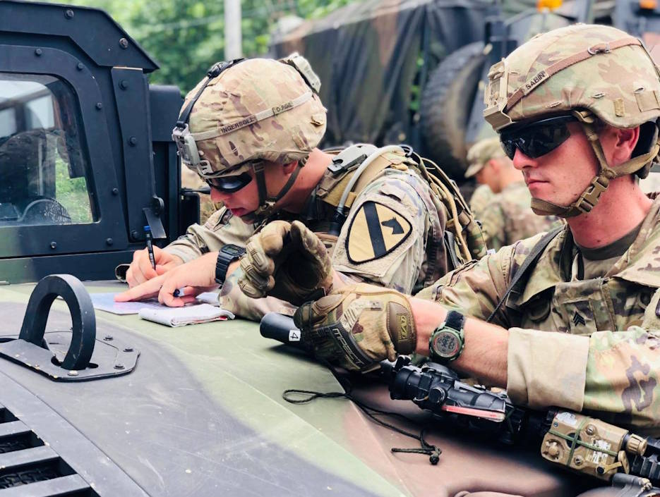 August 22, 2019 - Spc. Benjamin Ingersoll and Sgt. Zachary Sabin with C Co., 3-8 Cav. Regt., 3rd Armored Brigade Combat Team, 1st Cavalry Division conduct planning prior to starting lanes during the Team Leader Academy held at Camp Hovey, Republic Of Korea August 20-23, 2019. The course teaches current and future team leaders how to think and act tactically as a team during operations. (U.S. Army photo by First Lt. Alyssa Chapman, 3-8 Cav)