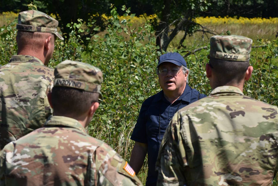 Civilian James Hughto gives New York Army National Guard Soldiers a tour of Saratoga Battlefield in Saratoga National Historical Park on August 14, 2019. The Soldiers of the New York Army National Guard were being given a tour of Saratoga Battlefield, during their training with the commander's career course. (New York Army National Guard photo by Sgt. Andrew Valenza)