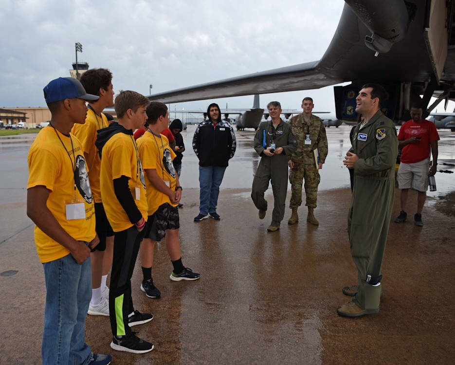 U.S. Air Force Capt. David Galluzzo, 28th Bomb Squadron range operations officer, answers students' questions at a B-1B Lancer static display at Dyess Air Force Base, Texas, May 18, 2019. Students learned about different aerospace, science, technology, engineering, mathematics and military career fields during the Eyes Above the Horizon event. (U.S. Air Force photo by Airman 1st Class River Bruce)