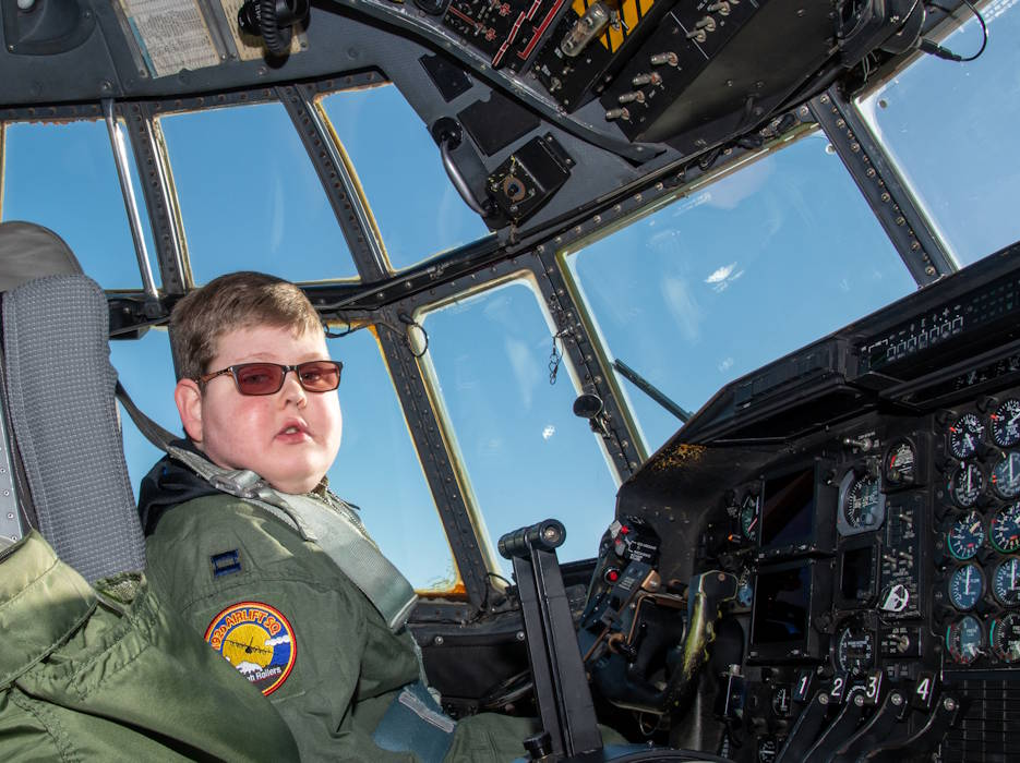 "December 16, 2019 - Capt. Tennison Hunter (call sign ""Wizard""), 152nd Airlift Wing pilot stops to pose for a photo during his Pilot for a Day event. The 152nd Airlift Wing honored ""Wizard"" for an entire day. He was sworn in that morning and retired at the end of the day. (U.S. Air Force photo by Senior Airman Matthew Greine)"