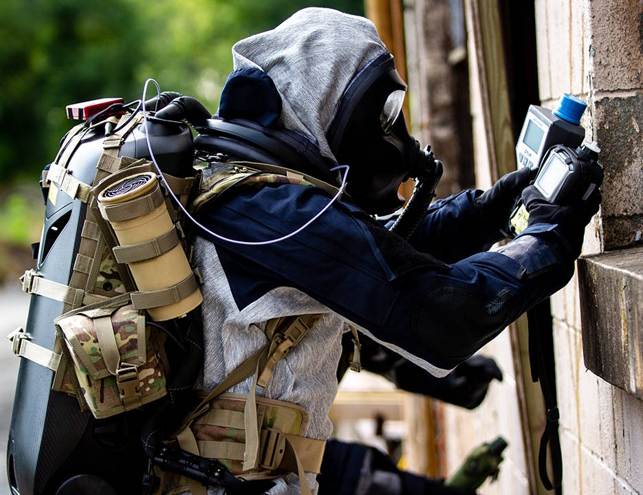 August 21, 2019 - A member of the West Virginia National Guard 35th Civil Support Team wears a prototype of the CCDC Chemical Biological Center respiration protection system as he performs a mock chemical materials investigation of a building. (U.S. Army photo by Jack Bunja, Combat Capabilities Development Command Chemical Biological Center)