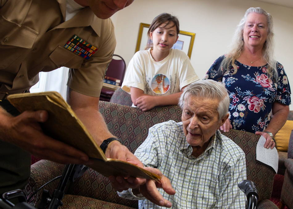 U.S. Marine Corps and WWII veteran Charles J. Kundert (92) discusses his World War II memorabilia with 10 Marines, who were visiting him at The Chateau at Harveston, Temecula, California ... as his daughter and great-granddaughter watch on June 11, 2019. (U.S. Marine Corps photo by Pfc. Melissa Ugalde)