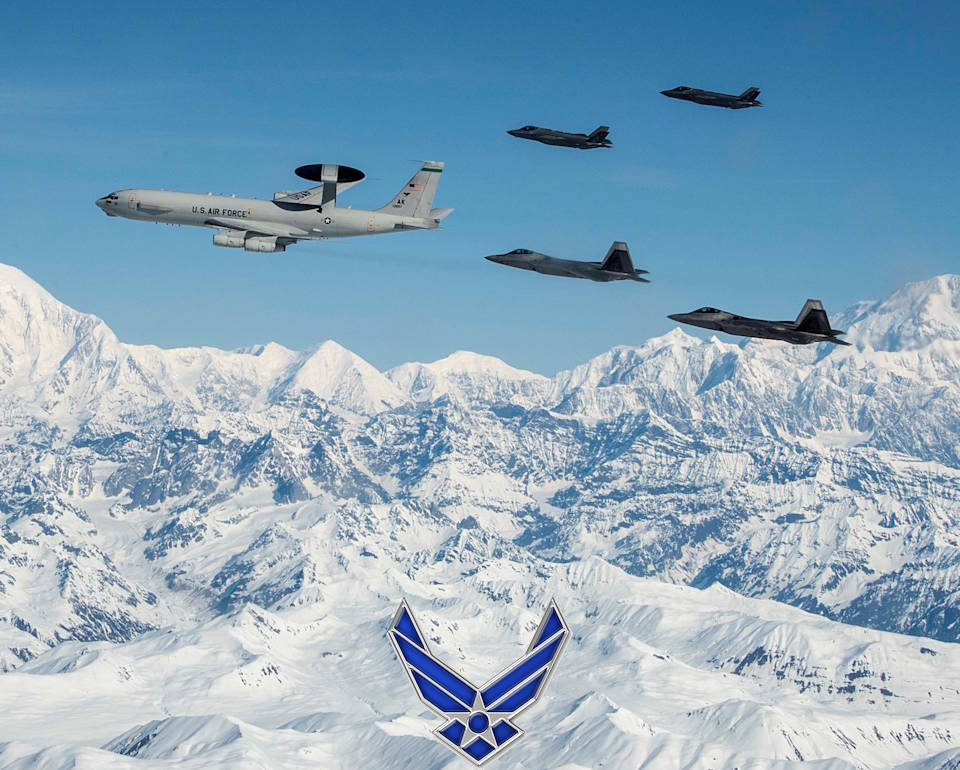 May 5, 2020 - A U.S. Air Force E-3 Sentry, an airborne warning and control system (AWACS), leads F-22 Raptors and F-35A Lightning IIs fighter aircraft during a flight formation over snow covered mountains in the clear blue Alaskan sky. (Image created by USA Patriotism! from U.S. Air Force photo by Tech. Sgt. Jerilyn Quintanilla.)