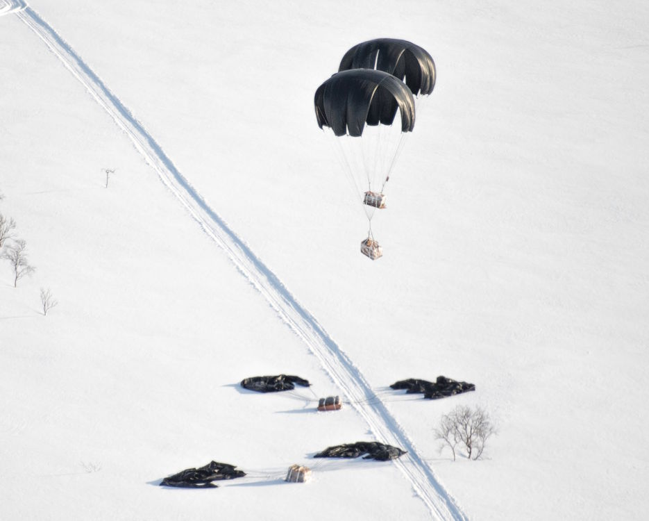 February 29, 2020 - Two low-cost, low-altitude resupply bundles descend to a drop zone from a C-130J Super Hercules assigned to the 37th Airlift Squadron, Ramstein Air Base, Germany, in Kiruna, Sweden. Tactical Air Control Party Airmen assigned to the 2nd Air Support Operations Squadron, Vilseck, Germany, and British Royal Marines Commandos assigned to the SRS received the LCLA bundles which were critical for life sustainment in the harsh Arctic conditions. The airdrops were part of events in preparation for Exercise Cold Response 20, a Norwegian Joint Headquarters exercise focused on joint and combined maritime, land and air operations. (U.S. Air Force photo by Staff Sgt. Devin Boyer)