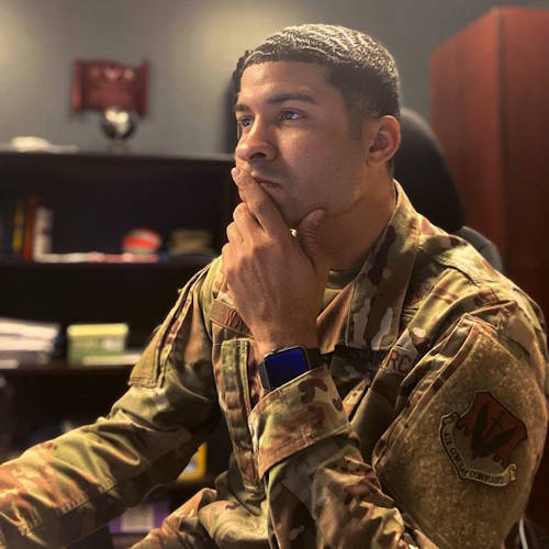 U.S. Air Force Staff Sgt. Justin Waters, 325th Fighter Wing equal opportunity noncommissioned officer in charge at his desk on April 6, 2020 at Tyndall Air Force Base, Florida. Waters has been leading the movement against suicide awareness and prevention. (U.S. Air Force Courtesy Photo)