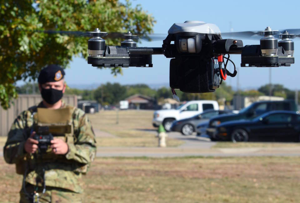 U.S. Air Force Tech. Sgt. Kyle McNeill, 17th Security Forces Squadron bravo flight chief and certified drone operator, creates a line of vision for the drone that he is operating outside of the 17th SFS headquarters, on Goodfellow Air Force Base, Texas, Nov. 5, 2020. The 17th SFS plans to expand its training to utilize the drone as a quick reaction tool in unpredictable situations. (U.S. Air Force photo by Airman 1st Class Ethan Sherwood)