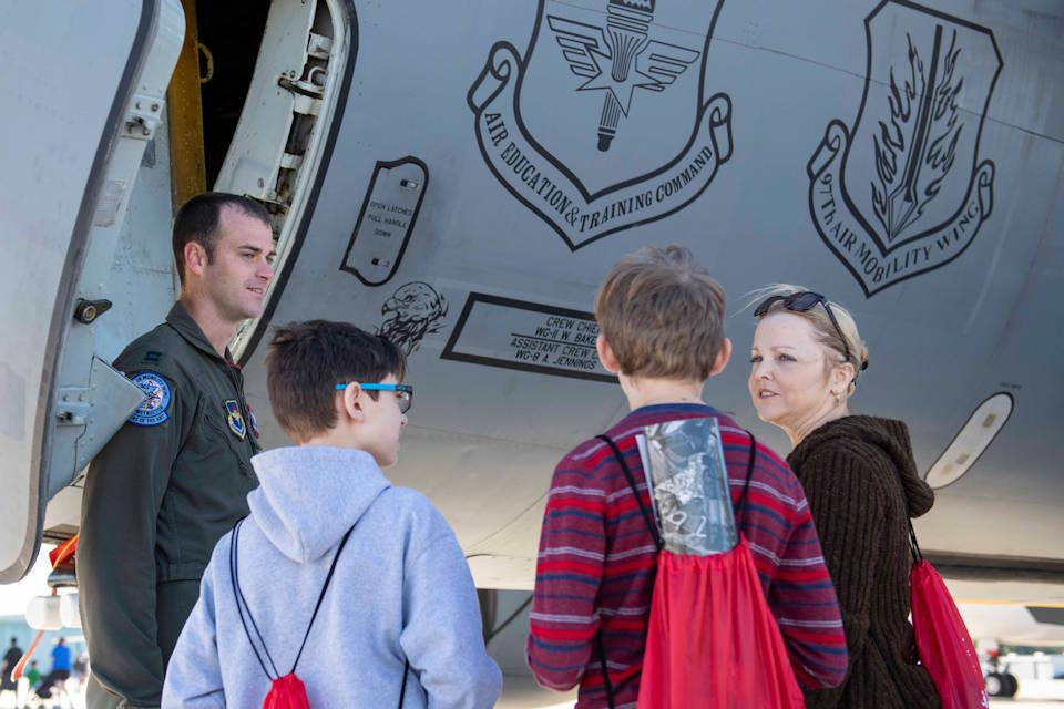 January 25, 2020 - U.S. Air Force Capt. Christian Allegood, a KC-135 Stratotanker instructor pilot assigned to the 97th Air Mobility Wing; Altus Air Force Base, OK, speaks to a family about the aircraft during the Aerospace and Aviation Day at Orlando Sanford International Airport, FL. For the first time; Mobility's Hometown sent C-17 Globemaster III and KC-135 crews to help educate; recruit and inspire young dreamers attending the event. (U.S. Air Force photo by Airman 1st Class Breanna Klemm)