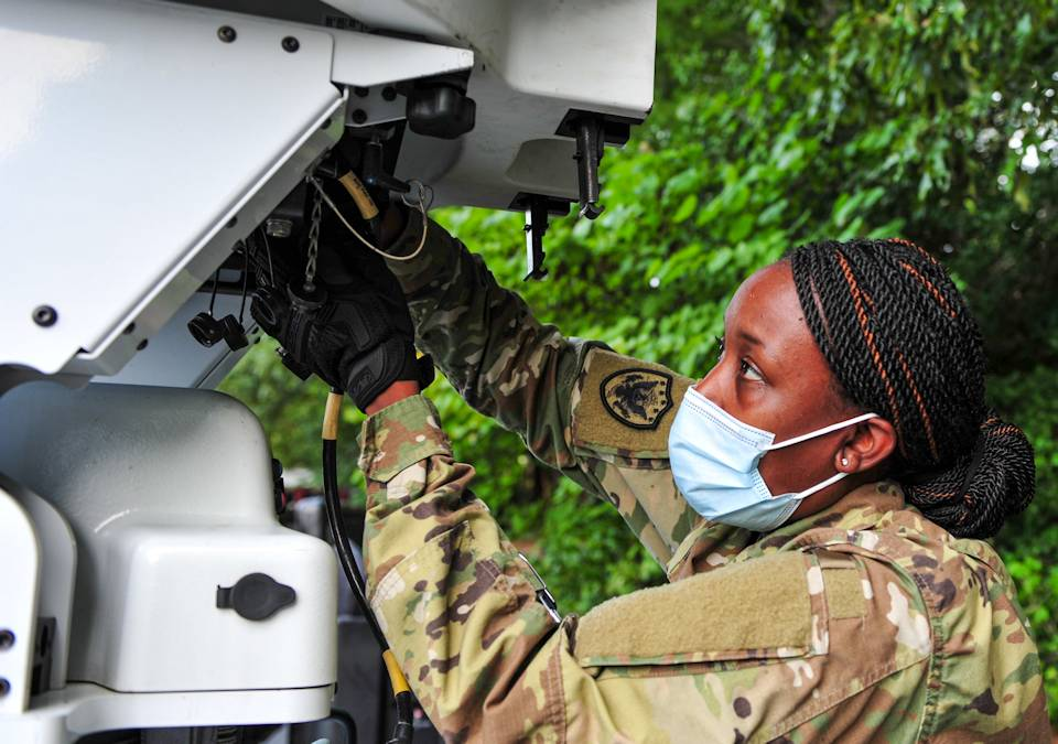 September 5, 2020 - Air Force Master Sgt. Lakisha DeJesus, assigned to Joint Task Force Civil Support, attaches a power supply to a satellite communication terminal outside a local hotel during Vibrant Response 20 Lite in Williamsburg, VA. (U.S. Navy photo by Petty Officer 2nd Class Michael H. Lehman)