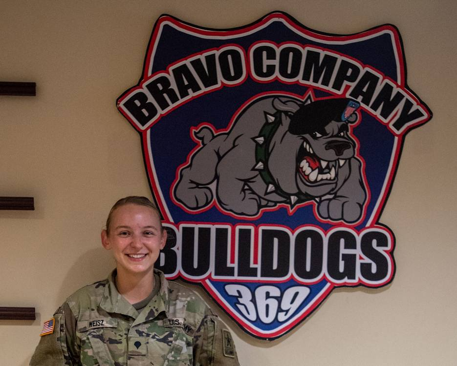 U.S. Army Spc. Alison Weisz in front of her Bravo Company sign. Weisz will became a member of the Army Marksmanship Unit when she graduated from Advanced Individual Training on October 8, 2020. She has already qualified for the 2021 Olympics in Tokyo. (U.S. Army photo by Josephine Carlson)