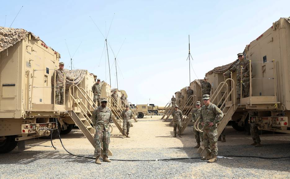 U.S. Army Major General Steven Ferrari stands with soldiers of Task Force Spartan at the site of their mobile command post exercise at Camp Arifjan, Kuwait on April 25, 2020. This exercise was designed to hone Soldiers skills setting up the mobile command post. (U.S. Army photo by Sgt. Trevor Cullen)