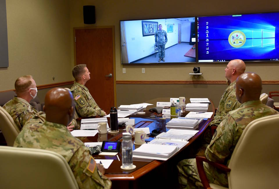 Army Staff Sgt. Taylor, a satellite network planner with the Satellite Operations Brigade at Wheeler Army Airfield, Hawaii, virtually addresses a board of six command sergeants major at Peterson Air Force Base, Colorado during the command's Best Warrior Competition on June 30, 2020. (U.S. Army photo by Dottie White)