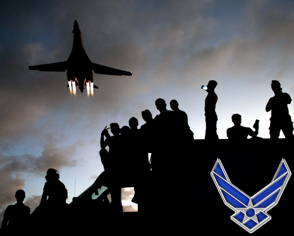 May 21, 2020 - U.S. Air Force 9th Expeditionary Bomb Squadron (EBS) B-1B Lancer mechanics watch as a B-1B flies over them at Andersen Air Force Base, Guam during sunset. (Image created by USA Patriotism! from U.S. Air Force photo by Senior Airman River Bruce)
