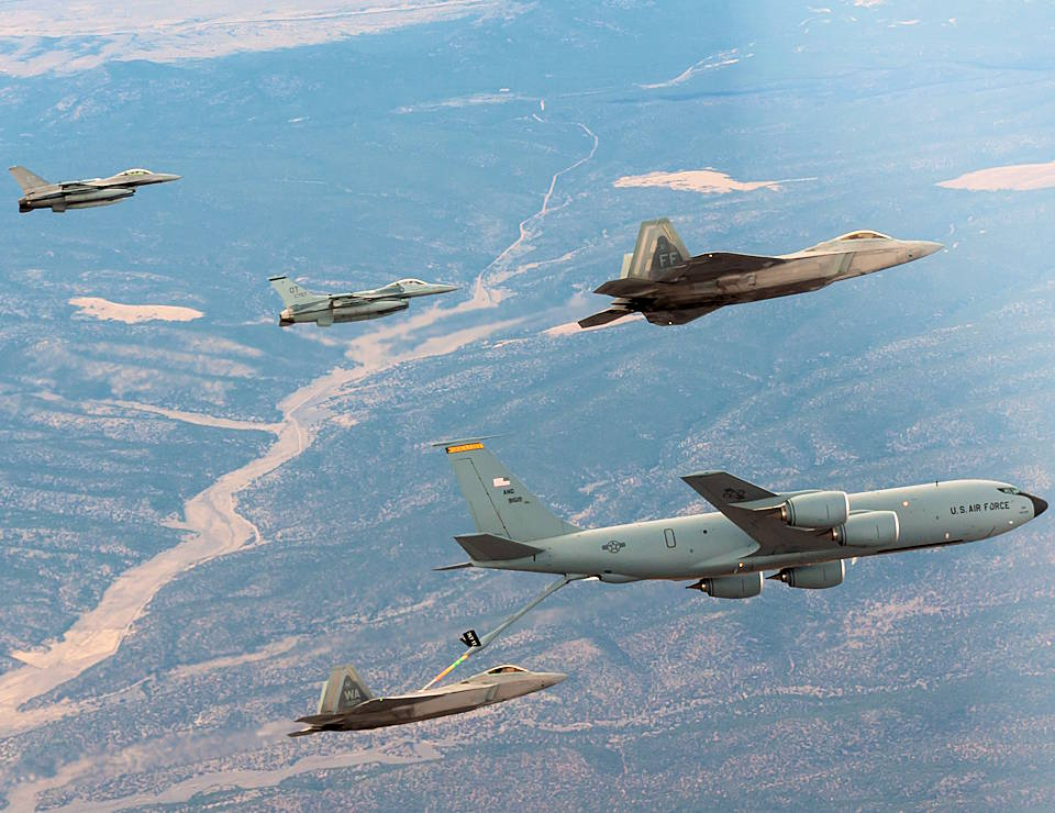 "F-16s and F-22s from the 422nd Test and Evaluation refuel from a KC-135 over the Nevada Test and Training Range on November 17, 2020 for Large Force Test Event 20.03. LFTE 20.03 was the beta version of ""Black Flag,"" a premier joint operational test event hosted by the 53rd Wing that validates tactics in a combat relevant environment. (U.S. Air Force photo by 1st Lt Savanah Bray)"