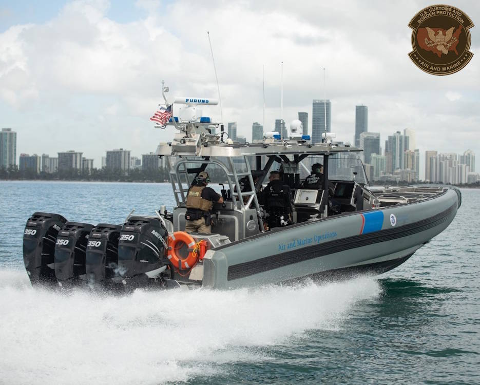 January 23, 2020 - U.S. Customs and Border Protection (CBP), Air and Marine Operations (AMO) agents train along the coast of Miami, Florida in their patrol boat prior to Super Bowl LIV. CBP is working alongside a vast network of South Florida public safety partners as part of coordinated security efforts ahead of the Super Bowl. (Image created by USA Patriotism! from U.S. Customs and Border Protection photo by Ozzy Trevino, Public Affairs)