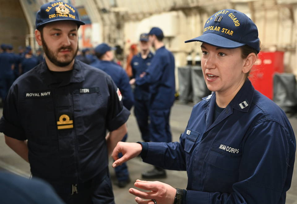 Marine Science Officer Lt. Lydia Ames, with the National Oceanic and Atmospheric Administration, discusses using expendable oceanographic data collection sensors to collect Arctic Data Monday with other Coast Guardsmen on December 14, 2020 while underway in the Bering Sea. (U.S. Coast Guard photo by Petty Officer 1st Class Cynthia Oldham)
