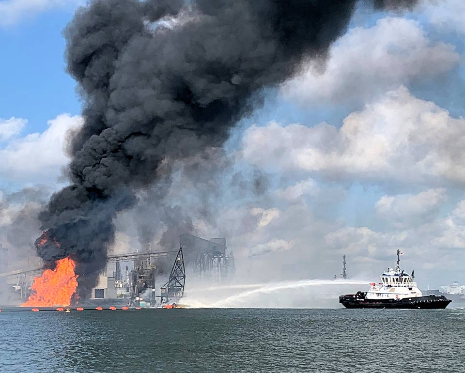 August 21, 2020 - U.S. Coast Guard crews respond to a dredge on fire in the Port of Corpus Christi Ship Channel. (Image created by USA Patriotism! from U.S. Coast Guard photo