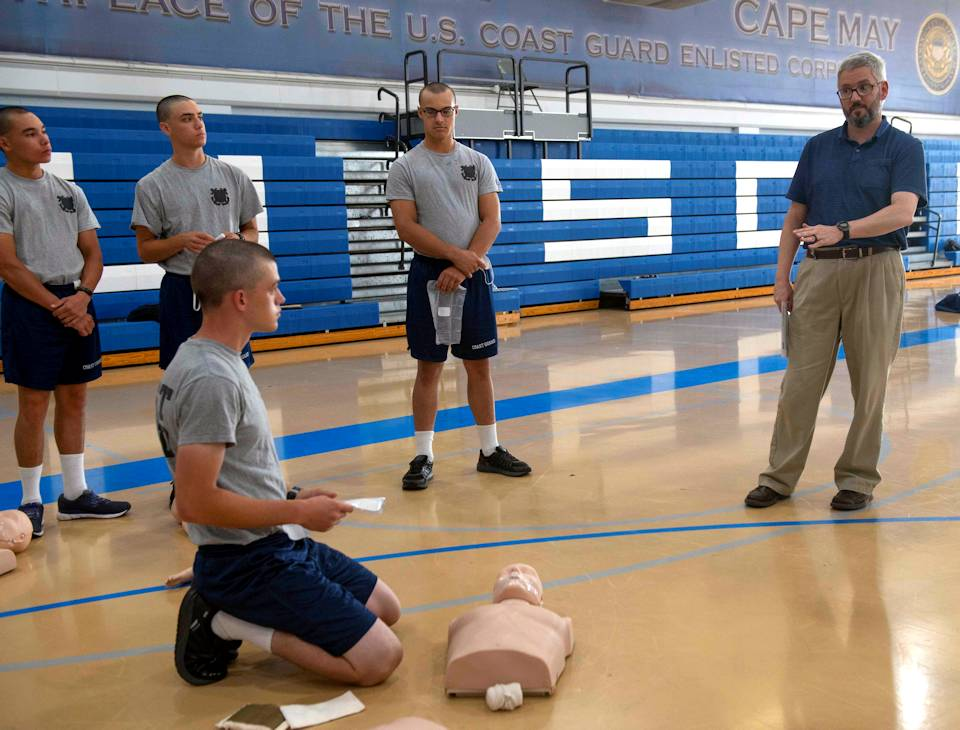 Matt Smith, the Civilian of the Quarter for April - June 2020, teaches recruits how to administer CPR and first aid on August 25, 2020 aboard Training Center Cape May, New Jersey. Our Training Center staff serve the American public by leveraging their talent and passion to produce mission-ready recruits, and delivering professional, high-quality services to enable future missions for our units, tenants, and regions. (U.S. Coast Guard photo by Petty Officer 2nd Class Shannon Kearney)