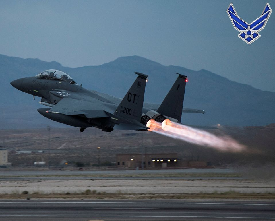June 2, 2020 - An F-15E Strike Eagle assigned to the 422nd Test and Evaluation Squadron (TES) takes off from Nellis Air Force Base, Nevada during early night. The 422nd TES utilizes an assortment of different airframes to test various capabilities that Nellis and the Nevada Test and Training Range can provide. (Image created by USA Patriotism! from U.S. Air Force photo by Airman 1st Class Bryan Guthrie.)