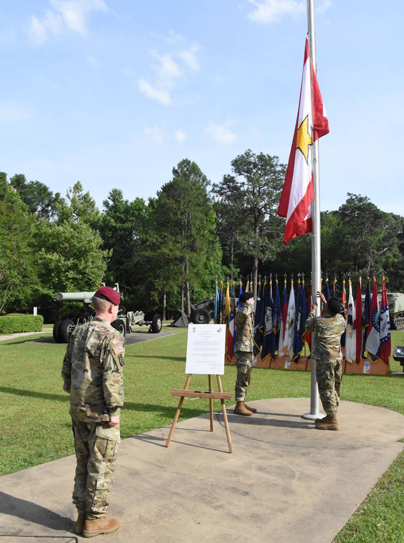 May 21, 2020 - U.S. Army Brig. Gen. Patrick D. Frank, commander, JRTC and Fort Polk, watches as Spc. Joshua D. Cardwell (left) and Sgt. Elvis V. Palarchie, both with Bayne-Jones Army Community Hospital, raise the Gold Star Family Flag at Warrior Memorial Park during a Memorial Day ceremony at Fort Polk. (U.S. Army Chuck Cannon, Fort Polk Public Affairs Office)