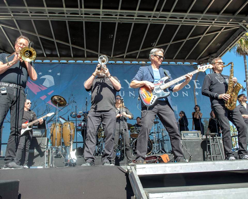 February 15, 2020 - Actor, musician, and patriot Gary Sinise and his Lt. Dan Band perform a concert during the 21st annual Invincible Spirit Festival at Naval Medical Center San Diego (NMCSD). The Invincible Spirit Festival's mission is to celebrate the courage of wounded service members, their families and caregivers. It is an initiative from the Gary Sinise Foundation which creates and supports unique programs designed to entertain, educate, inspire, strengthen and build communities. (Image created by USA Patriotism! from U.S. Navy photo by Mass Communication Specialist Seaman Luke Cunningham)