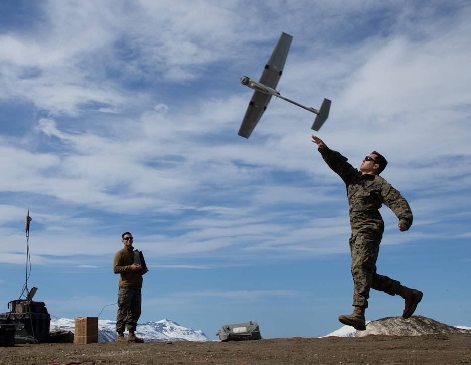 A Marine with Marine Rotational Force Europe 20.2, Marine Forces Europe and Africa, launches a Raven unmanned aerial system during training in Setermoen, Norway, June 1, 2020. (U.S. Marine Corps photo by Lance Cpl. Chase W. Drayer)