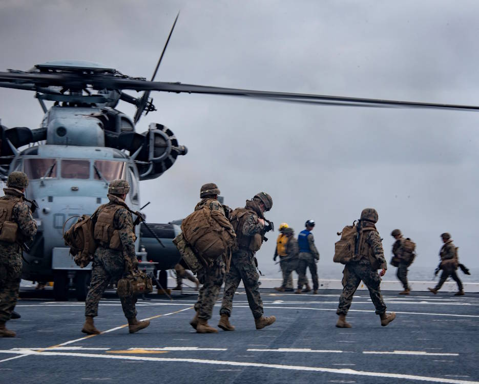 "February 9, 2020 – U.S. Marines board a CH-53E Super Stallion helicopter from the ""Warhorse"" of Marine Heavy Helicopter Squadron (HMH) 465 on the flight deck of the amphibious transport dock ship USS Portland (LPD 27) to simulate an air assault on San Clemente Island, California, during Exercise Iron Fist 2020. (U.S. Navy photo by Mass Communication Specialist 2nd Class Jessica Paulauskas)"