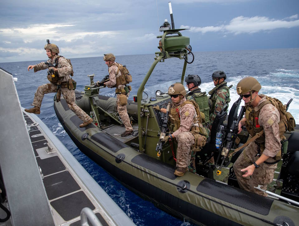 U.S. Marines with C Company, 2d Reconnaissance Battalion (Recon Bn.), 2d Marine Division (MARDIV) and Netherlands Marines with the 32nd Raiding Squadron near Netherlands Marine Barracks Savaneta, Aruba, board a boat during visit, board, search, and seizure (VBSS) training on Nov. 13, 2020. Being able to learn from the Dutch Marines in their primary area of operation helps 2d Recon Bn. build a faster, more mobile, and more lethal force when operating in diverse locations. (U.S. Marine Corps photo by Lance Cpl. Brian Bolin Jr.)