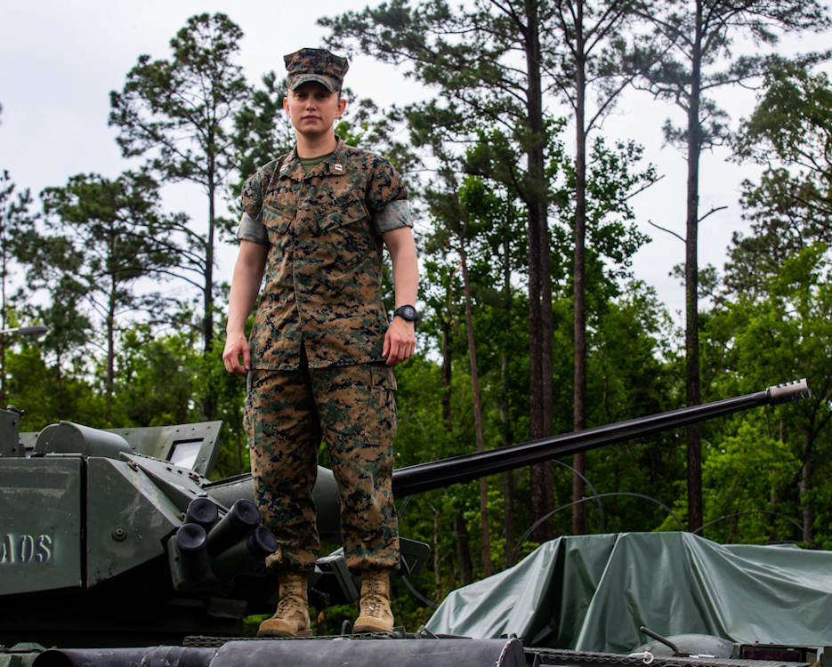 May 6, 2020 - U.S. Marine Corps Capt. Nicholle Miller, the intelligence officer for 2nd Light Armored Reconnaissance Battalion (LAR), 2d Marine Division poses for a photo on top of a Light Armored Vehicle-25 at Camp Lejeune, North Carolina. Miller is the first female officer to serve with an LAR unit in the Marine Corps. (U.S. Marine Corps photo by Lance Cpl. Brian Bolin Jr.)