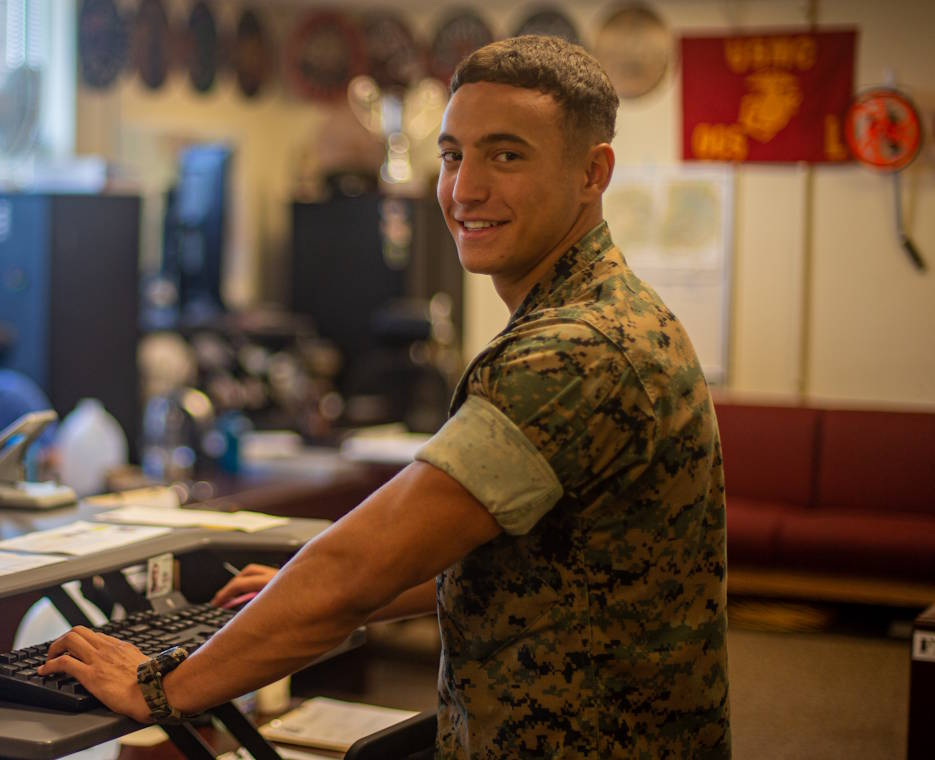 October 6, 2020 - U.S. Marine Corps Lance Cpl. Nicolas Gonzalez-Alzate, a radio operator with 8th Communication Battalion, II Marine Expeditionary Force Information Group, II Marine Expeditionary Force, performing a task on Camp Lejeune, NC. Gonzalez-Alzate, a native of Bogota, Colombia, is one of many individual stories that represents National Hispanic Heritage Month of overcoming obstacles and challenges. (Image created by USA Patriotism! from U.S. Marine Corps photo by Lance Cpl. Armando Elizalde.)