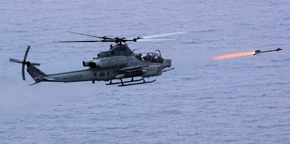 March 23, 2020 - An AH-1Z Viper helicopter with Marine Medium Tiltrotor Squadron (VMM) 265 (Reinforced), 31st Marine Expeditionary Unit (MEU), fires an AIM-9M sidewinder missile at a maritime target during a live fire exercise. During the exercise, the attack helicopters took off from San Antonio-class dock landing ship USS Green Bay (LPD 20) in order to protect the amphibious task force from a simulated maritime threat. (U.S. Marine Corps photo by Colton K. Garrett)