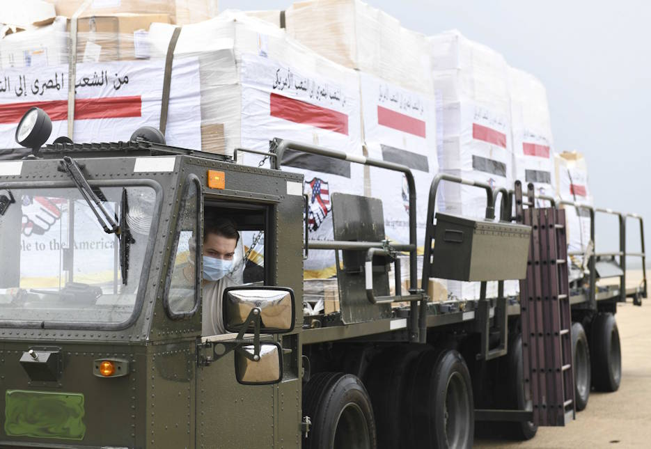 A service member transports medical supplies delivered by the Egyptian military at Joint Base Andrews, Maryland on April 21, 2020 to support COVID-19 response efforts. (U.S. Air Force courtesy photo)