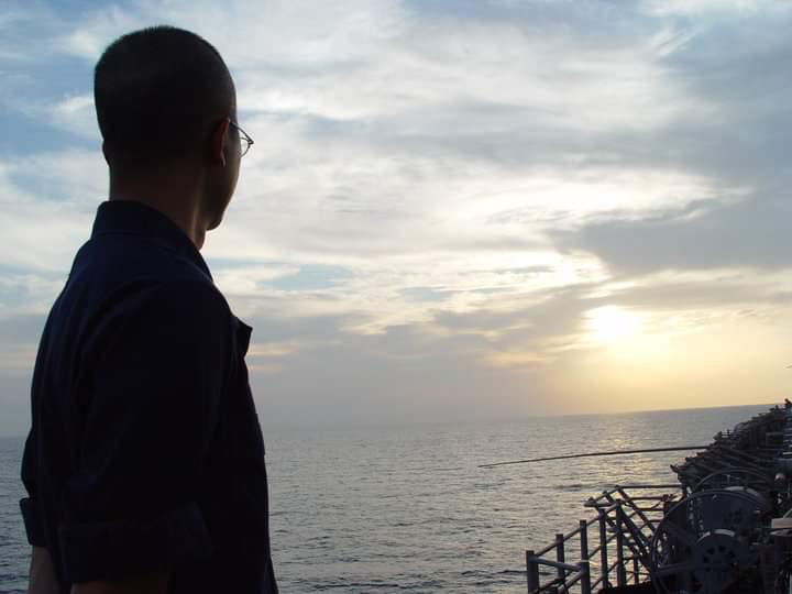 February 10, 2009 - Machinery Repairman 1st Class Fue Lor looks out over the ocean while on deployment with the amphibious assault ship USS Iwo Jima (LHD 7). (U.S. Navy courtesy photo from Machinery Repairman 1st Class Fue Lor)