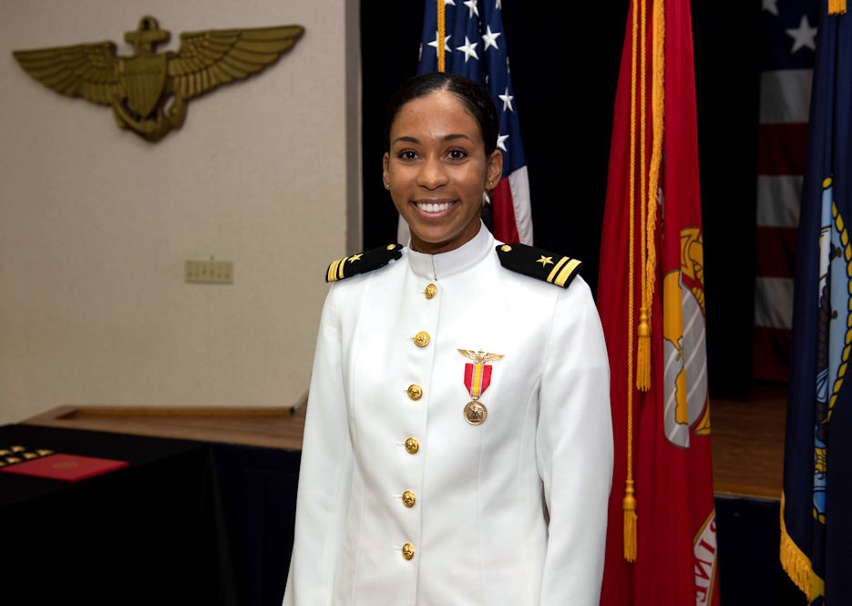 "July 31, 2020 - Lt. j.g. Madeline Swegle receives her naval aviator Wings of Gold during a ceremony aboard Naval Air Station Kingsville. Swegle is the U.S. Navy's first Black female tactical jet pilot and will proceed to graduate-level flight training with the ""Vikings"" of Electronic Attack Squadron 129 at NAS Whidbey Island, Washington, where she will fly the EA-18G Growler. (U.S. Navy photo by Anne Owens)"