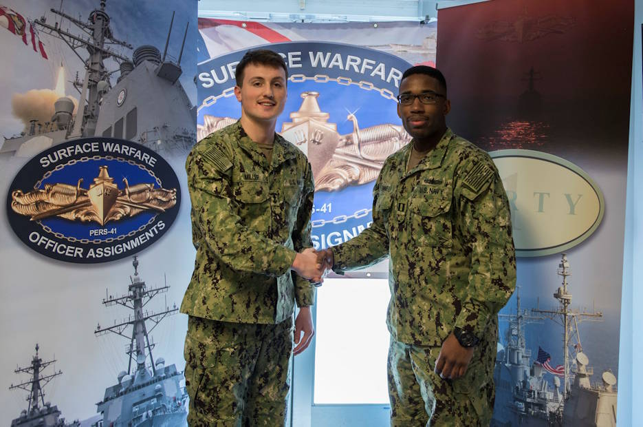 February 27, 2020 - Lt. Kevyn Evans congratulates Midshipman 1st Class Caldwell Miller upon selecting his first ship at Navy Personnel Command during the 2020 Naval Reserve Officer Training Corps (NROTC) spring ship selection. (U.S. Navy photo by Petty Officer 3rd Class Jared Catlett)